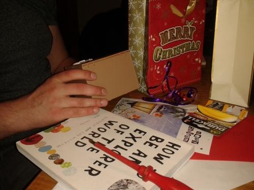 Boyf opening prezzies on Christmas Eve